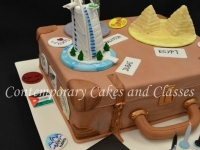 Travelling-suitcase-cake-with-Egypts-pyramidsThe-Petronas-Towers-Burj-Al-Arab-tower-made-from-sugar-paste-2