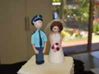 Bride and Policeman Groom figurine wedding toppers by Contemporary Cakes Brisbane