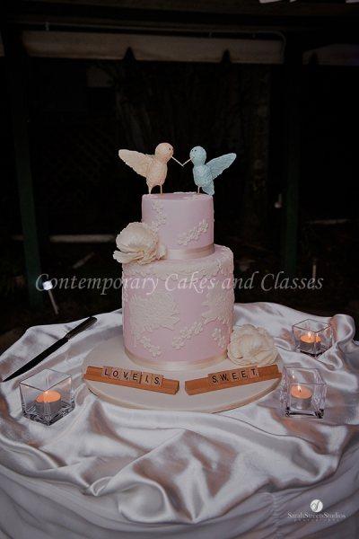 Double barrel cake with handmade love birds
