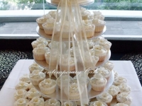 Piped swirl with blossom sugar flower cupcakes by Contemporary Cakes