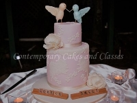 Double barrel cake with handmade love birds