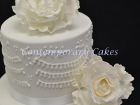 Peony roses and piped detailed wedding cake