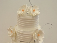 Wedding cake with open fantasy sugar flowers