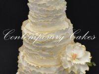 Ruffled wedding cake with gilded gold edging