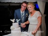 Double barrel wedding cake with handmade sugar lovebirds