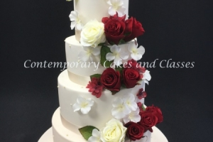 Cascading roses wedding cake with piped pearls