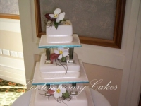 3 tier pillared wedding cake with sugar phaelonopsis orchids