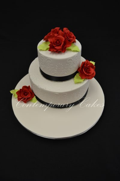Roses and piped detailed wedding cake
