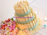 White chocolate paneled wedding cake